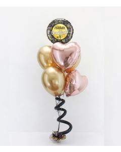 Bouquet con Helio Certificado, con globos de microfoil redondos y corazones y látex, sostenidos por un tuft como base con un espiral