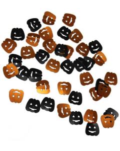 Confetti de mesa de calabazas sonrientes negras y naranjas